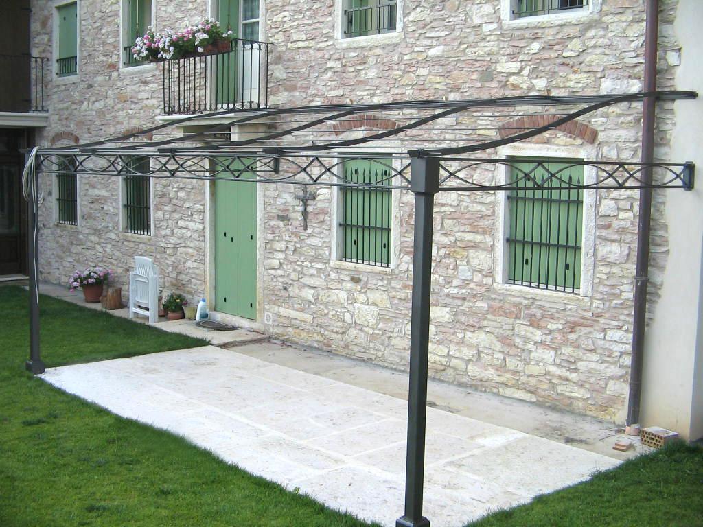 Tettoie in legno e ferro verande a vetri a scomparsa in for Immagini di tettoie in legno